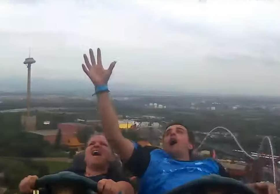 Image result for man catches stranger's phone on roller coaster