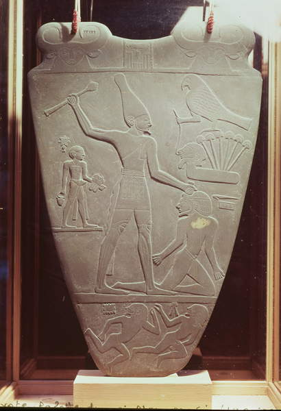 Image of The Narmer Palette: ceremonial palette depicting King Narmer, wearing the white crown of Upper Egypt, striking a prisoner, found at Hieraconpolis, Early Dynastic Period, c.3000 BC, Egyptian 1st Dynasty (c.3100-2890 BC) / Egyptian, Egyptian National Museum, Cairo, Egypt, 64x42 cms, © Bridgeman Images