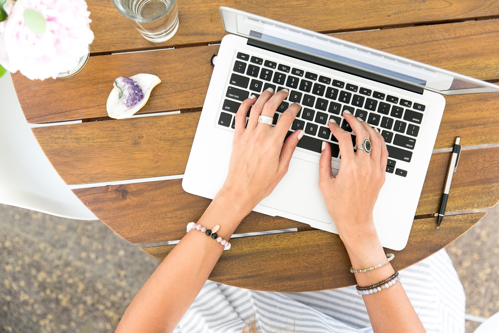 woman typing on how to grow a blog