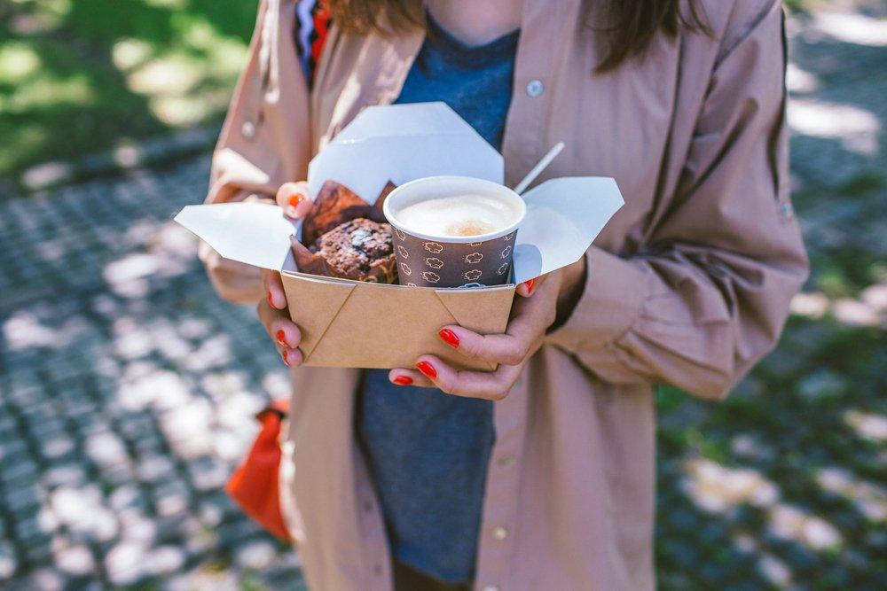 Woman with takeaway breakfast box