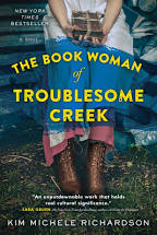 Book cover: The Book Woman of Troublesome Creek, Kim Michele Richardson; image of old-timey country woman sitting in a chair and holding a stack of books in her lap