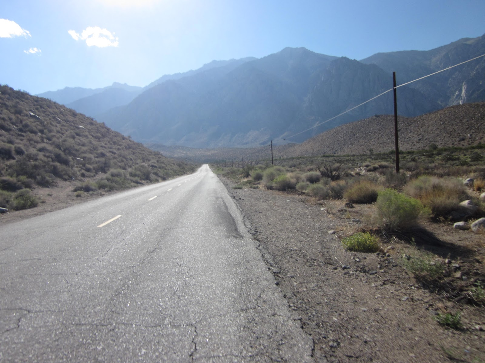 Bicycle ride up Pine Creek Road - Owens Valley - start of climb - road and canyon