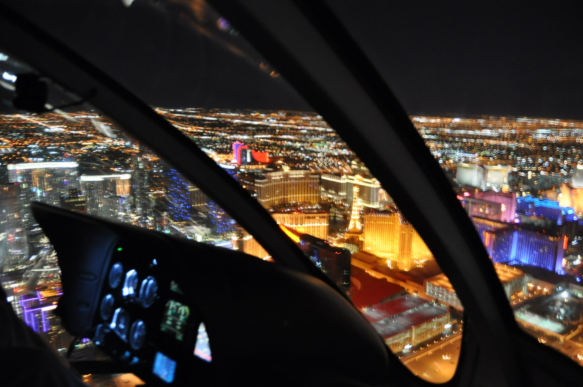 helicopter ride over a brightly lit city