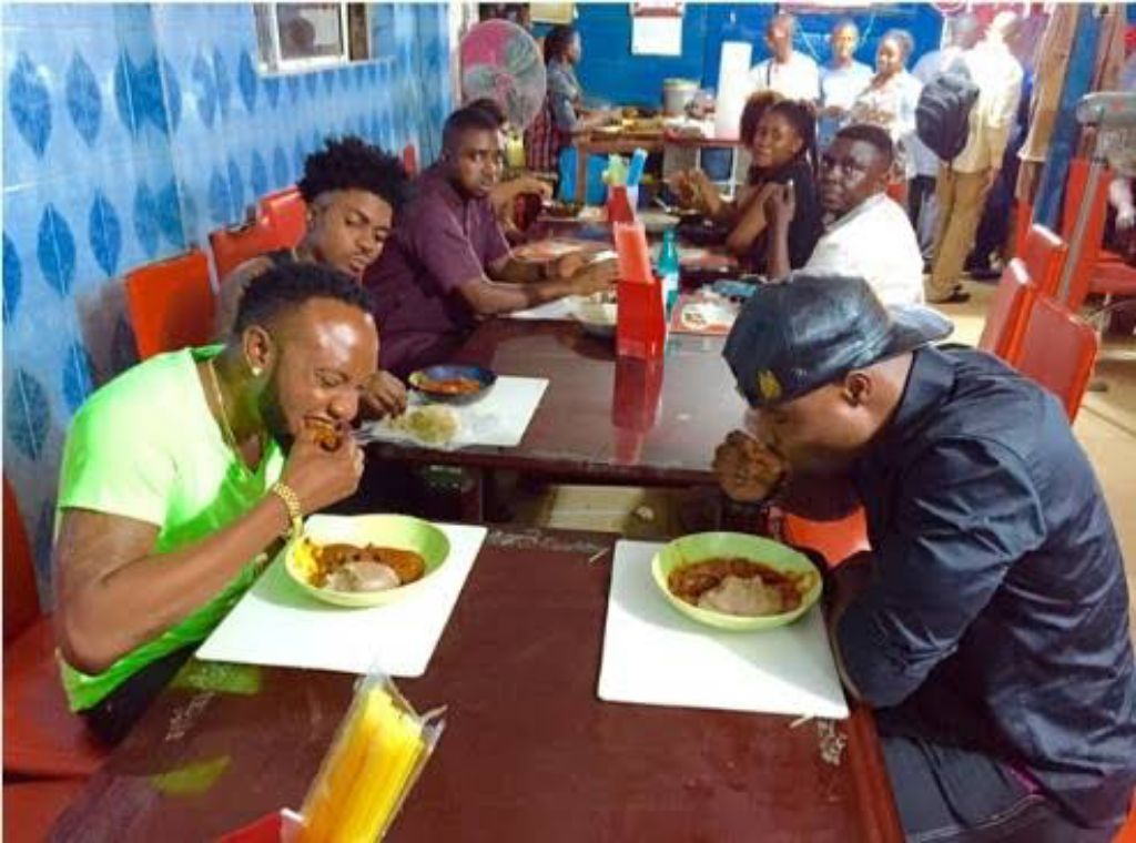 Men eating amala and goat meat