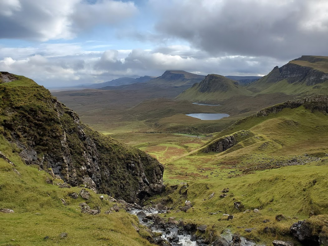 An image of the rolling hills of the Isle of Skye in the Scottish Highlands.