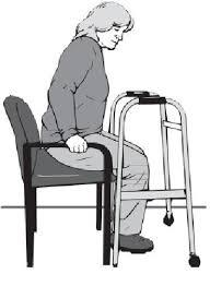 a women get up on the chair with the walker help