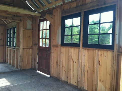 Black windows and dutch door in shed