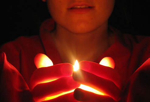 thinkstock_rf_photo_of_woman_holding_candle.jpg
