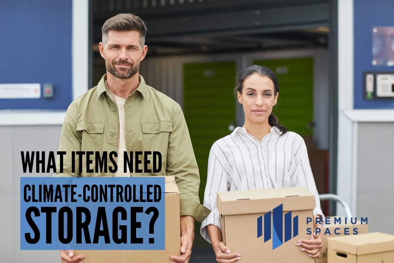 Man and woman holding boxes staring straight ahead