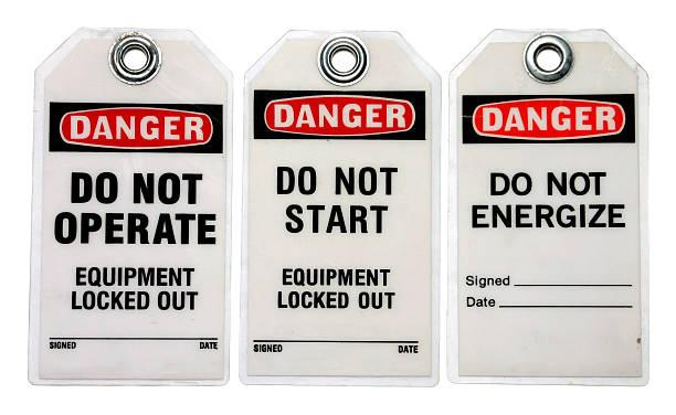 Three danger lockout tags about equipment Lockout Tagout Tags lockout tagout stock pictures, royalty-free photos & images
