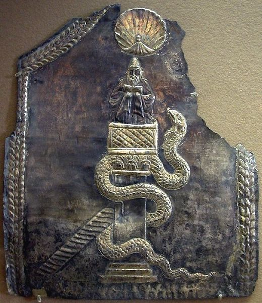Brass relief of St. Simeon sitting on top of a pillar, with a shell symbolizing wisdom above his head and a serpent symbolizing temptation crawling up the pillar.