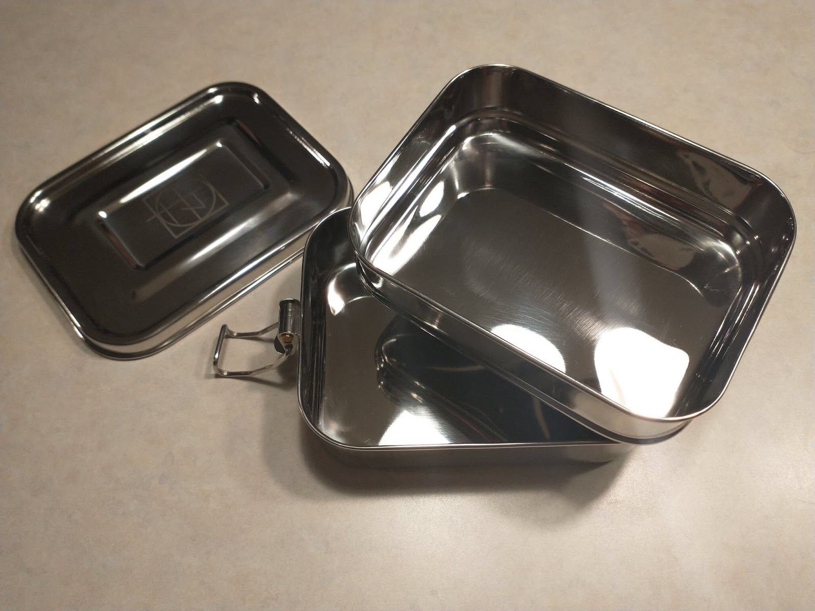 Stainless steel bento-style lunch box with two layers