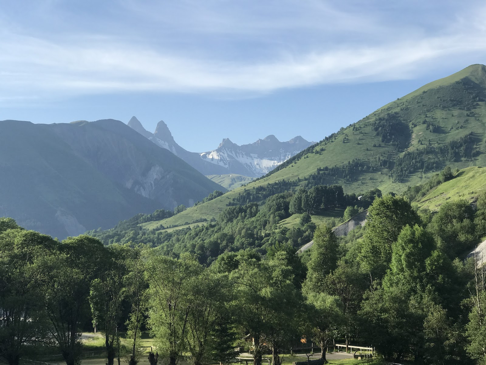 Climbing Col de la Croix de Fer, Saint-Jean-de-Maurienne by bike - view of forest and mountains