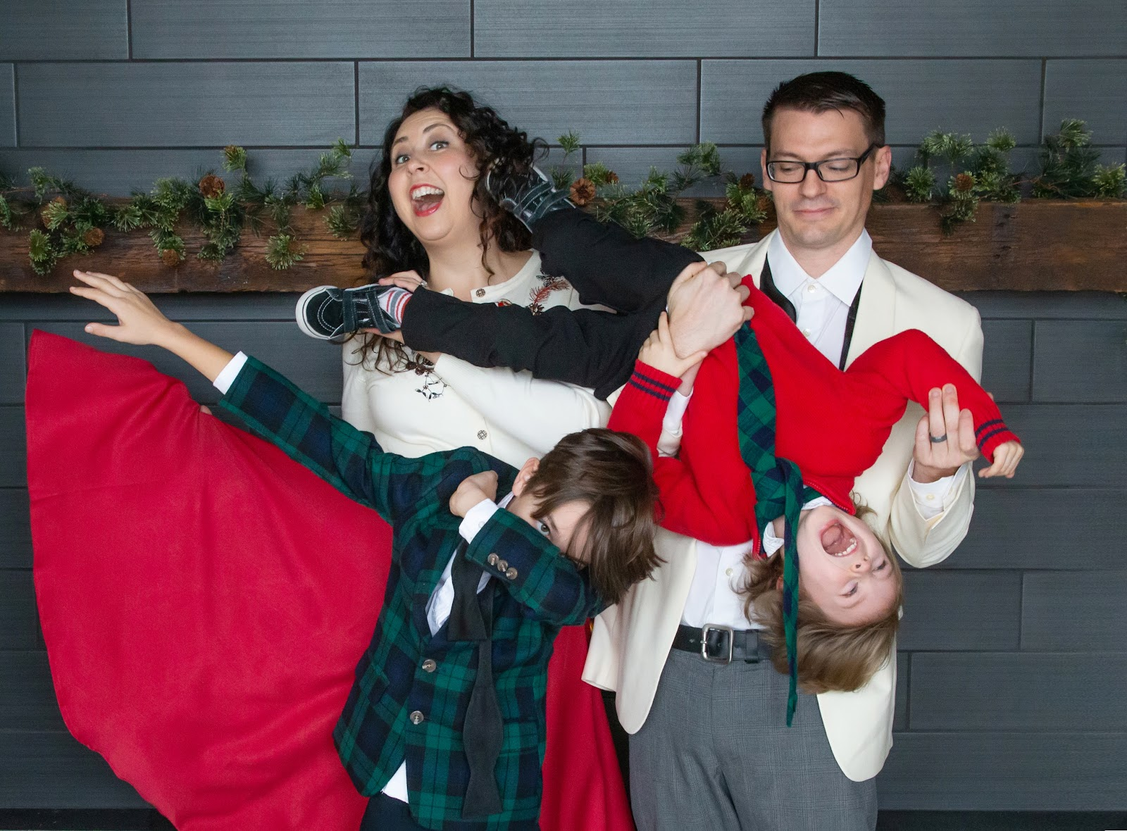 fun christmas card pose of family in formal christmas clothes for a holiday card
