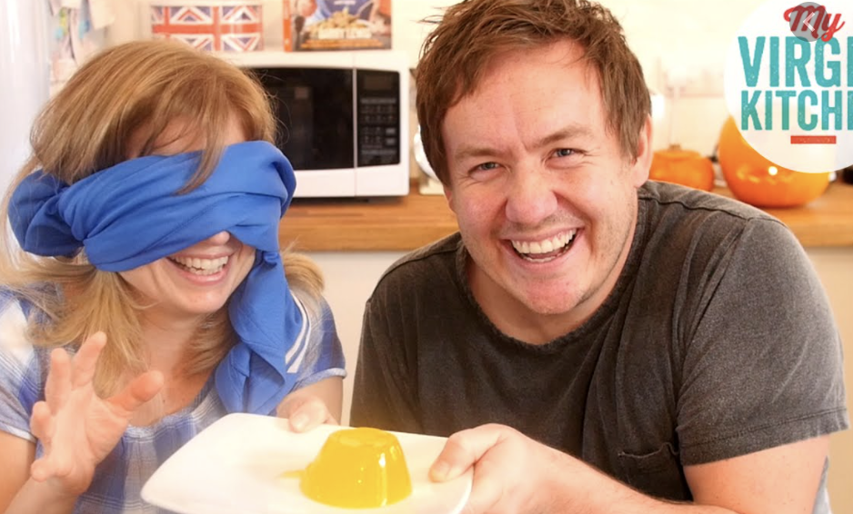 """Food bloggers playing """"What Am I Eating"""", with one person blindfolded."""