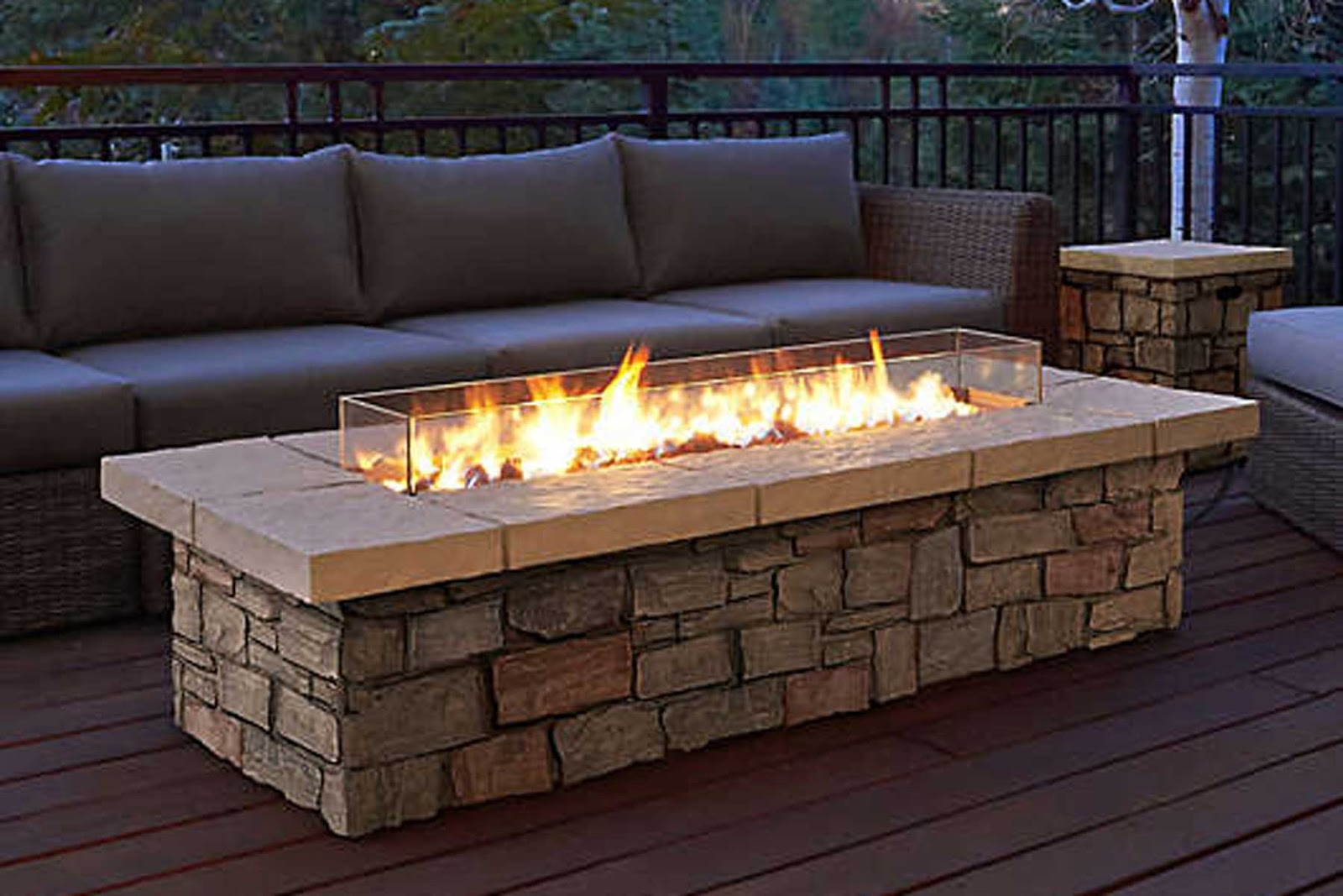 couch and stone rectangular fire-pit