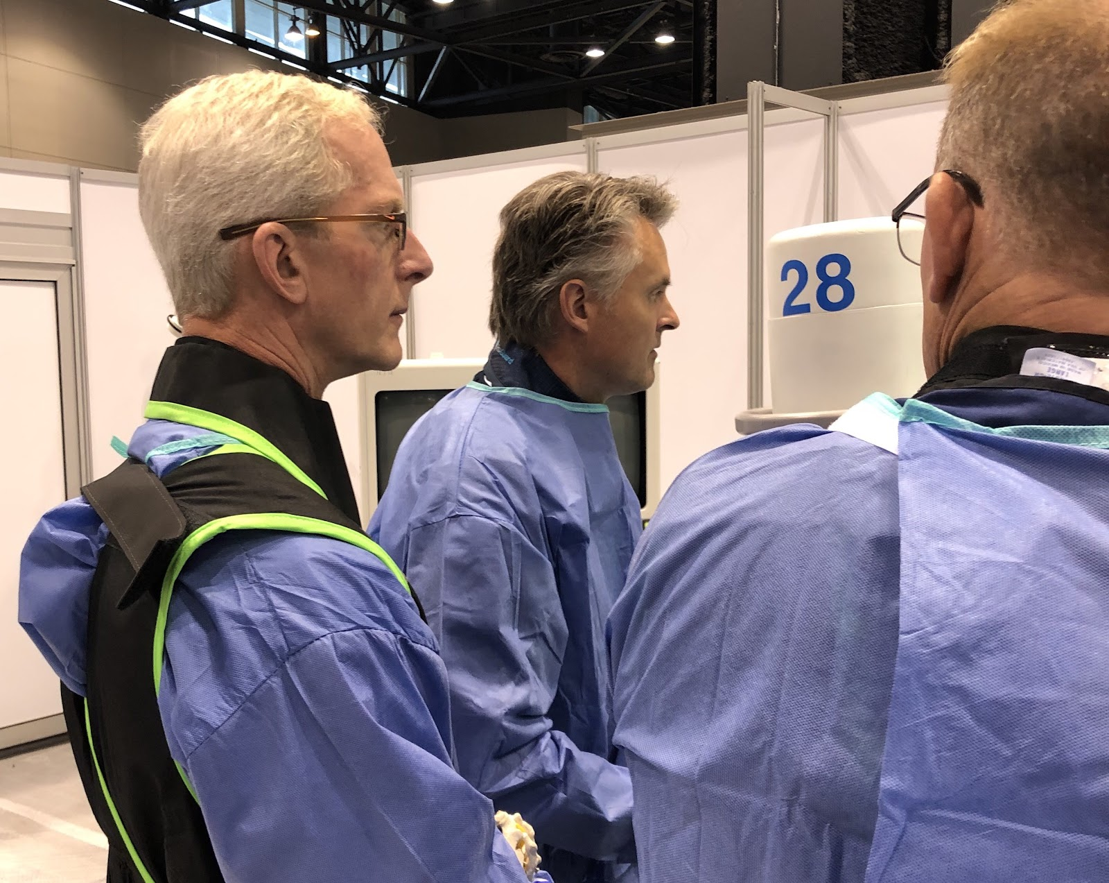 Dr. Hanson and other spine surgeons study a surgical technique at the NASS conference.