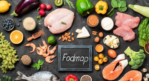 What foods should be avoided with SIBO: low-FODMAP foods on black background