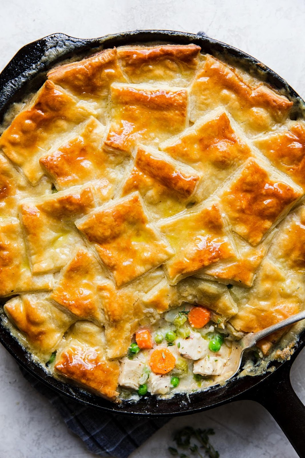 puff pastry chicken pot pie with vegetables made in a skillet