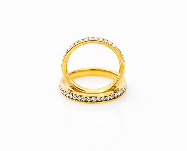 Gold wedding rings on white Premium Photo