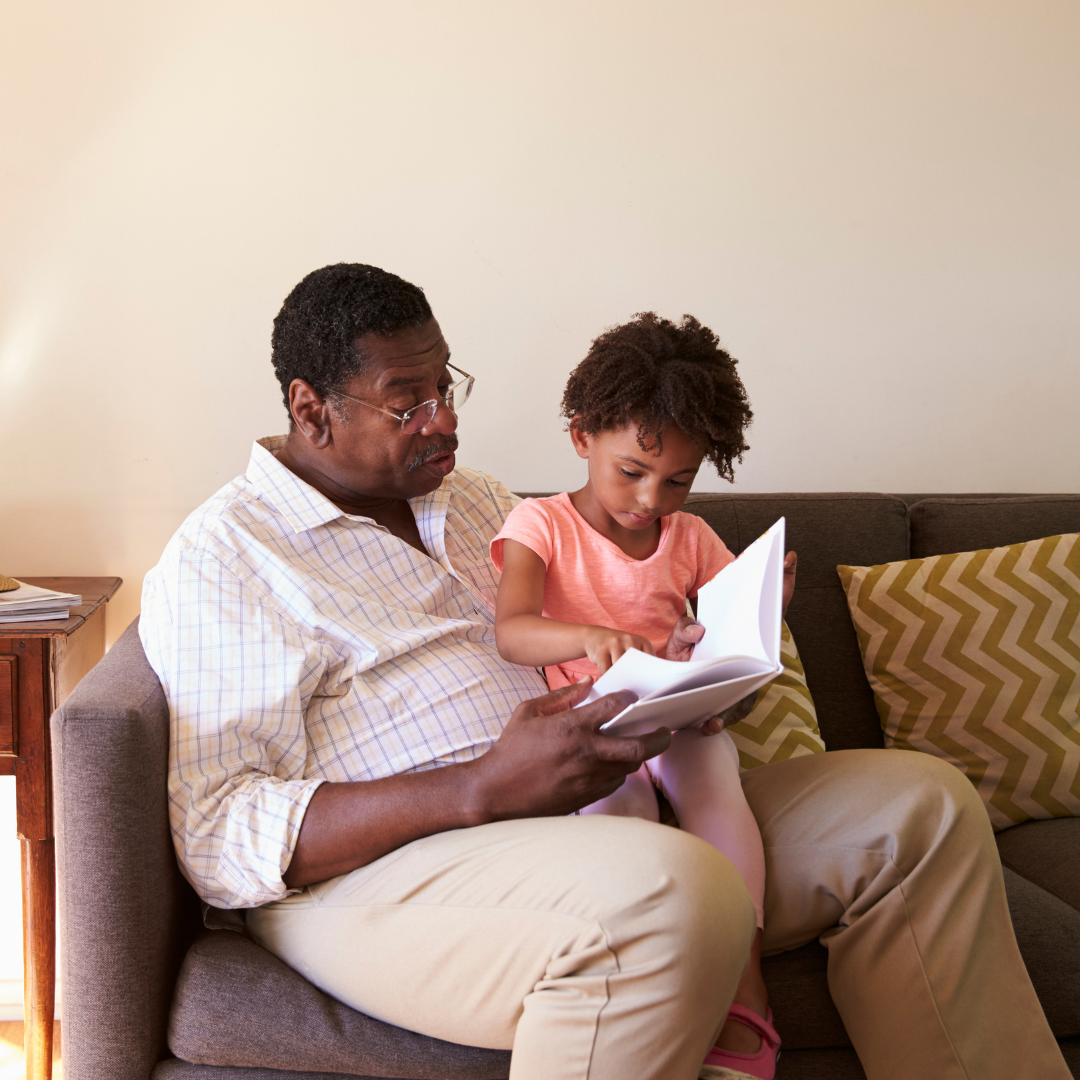 grandfather teaching and sharing stories with child