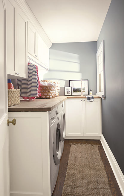 Laundry room walls painted in blue gray paint colour with pearl finish