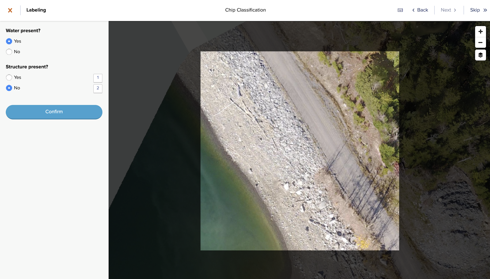 A screen shot of the GroundWork labeling tool. The labeler is asked to classify an image of a beachside road as having water and/or structures.