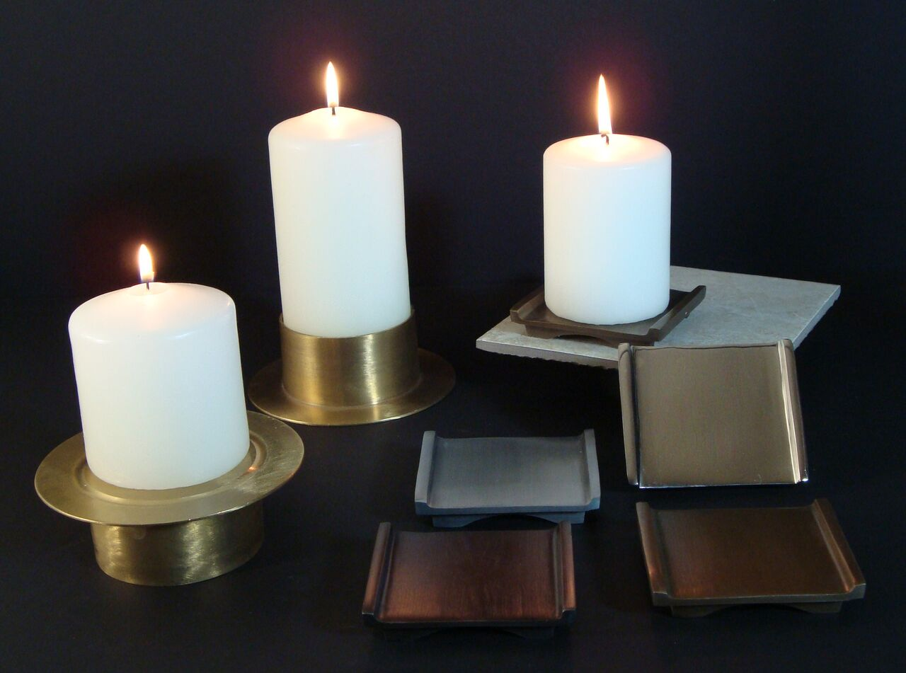 Short pillar candles and pillar holders