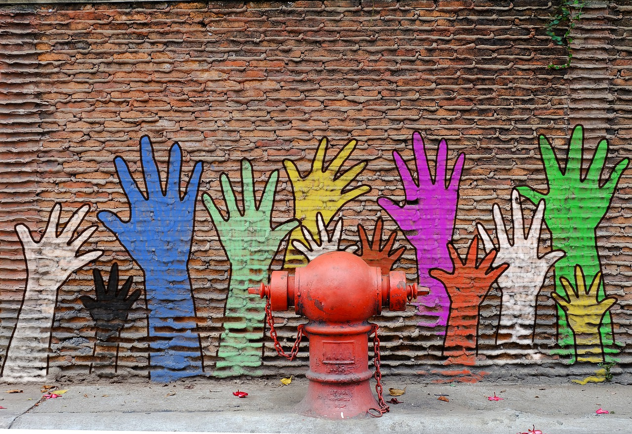 mural of hands on a wall