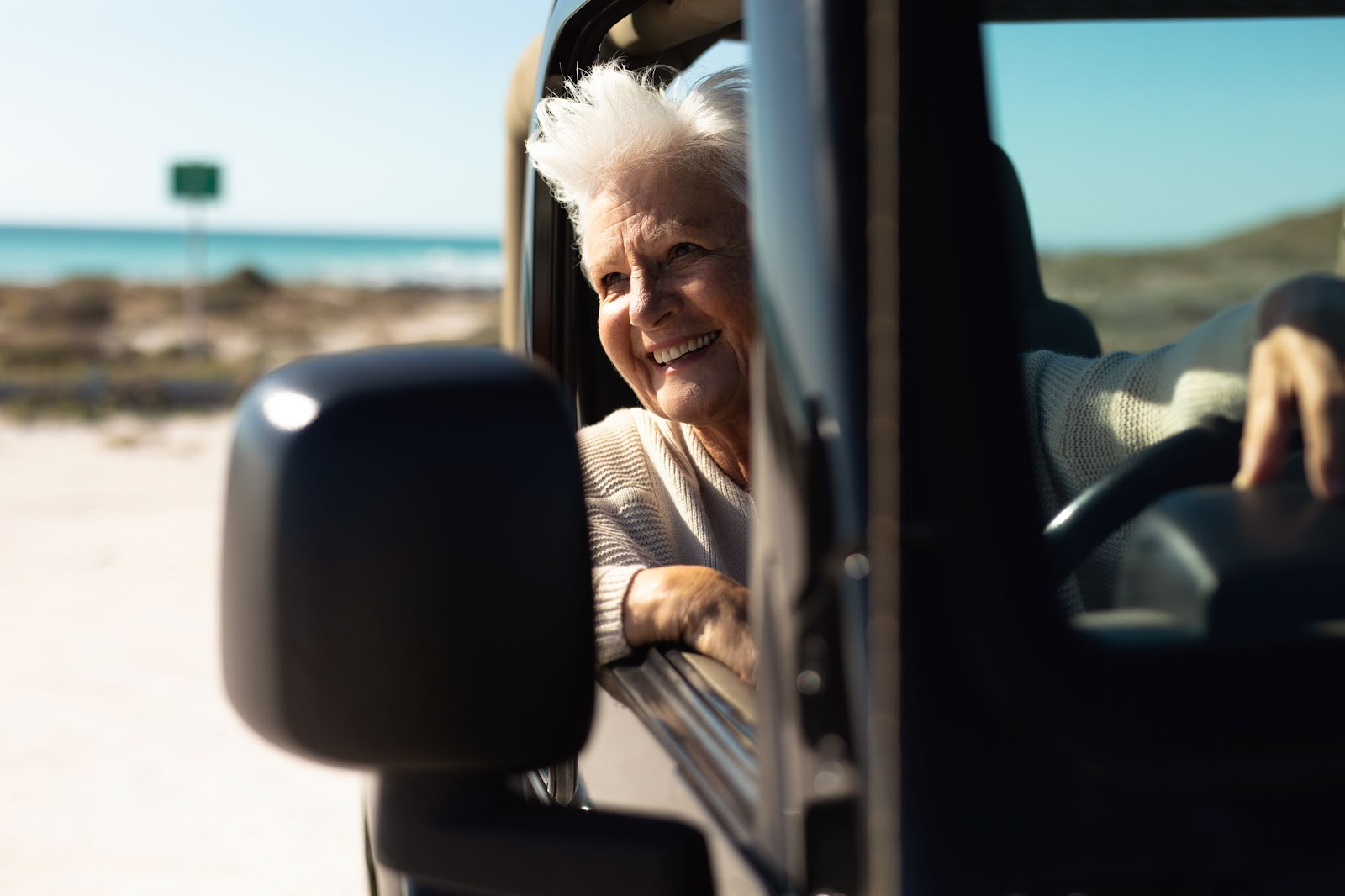 older-woman-in-car-at-the-beach