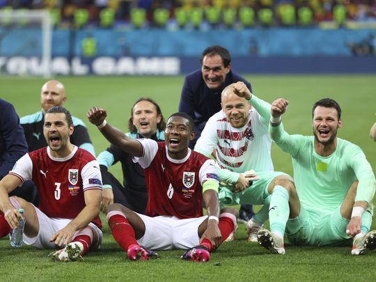 Austria players celebrating qualification to Round of 16