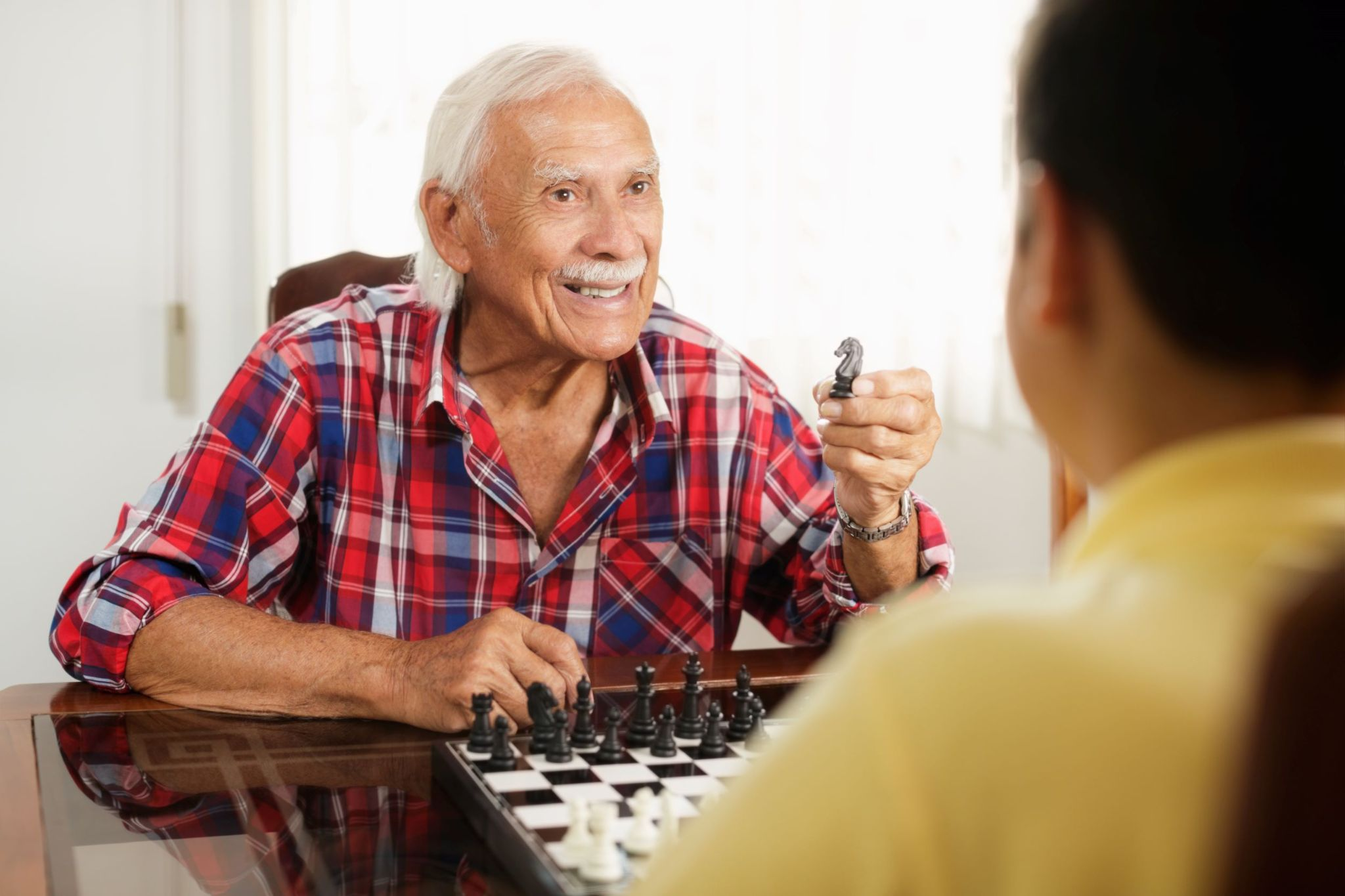 grandfather-and-grandson-playing-chess