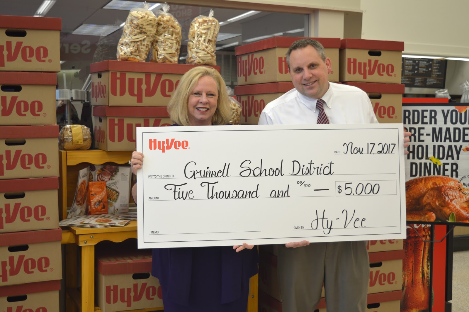 Dr. Stutz receiving a $5,000 donation from Hy-Vee