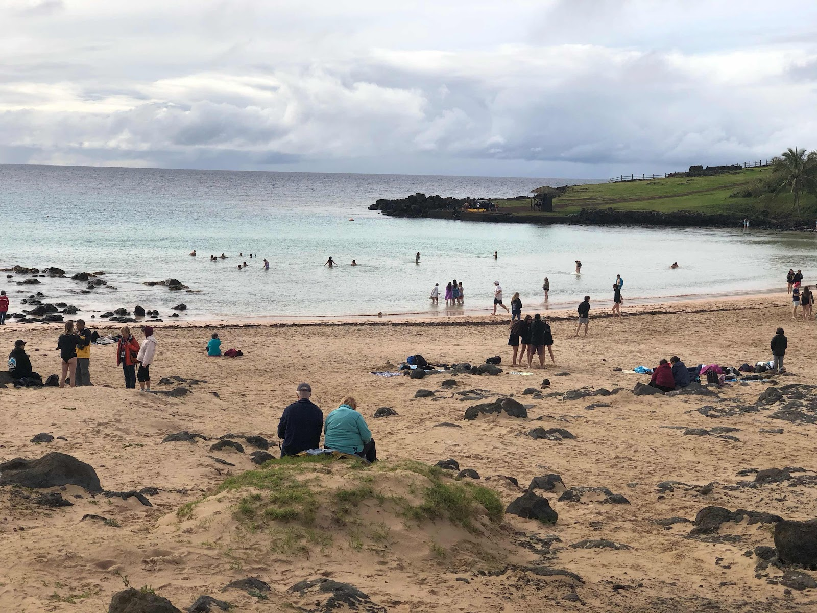 it's winter in Rapa Nui, but the swimmers see a great time at the beach