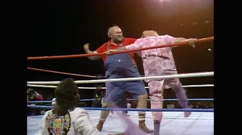 Uncle Elmer vs Adrian Adonis WM2 (WWE).jpg