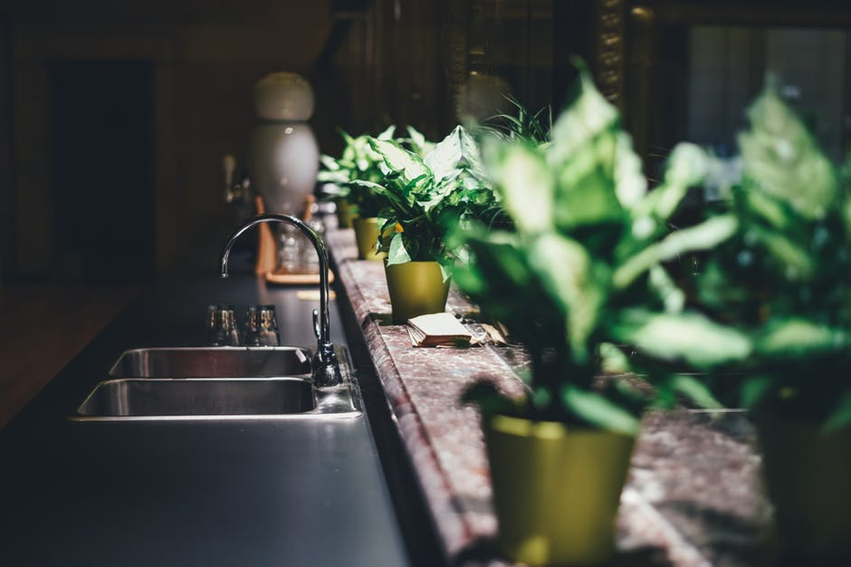 Shallow Focus Photography of Silver Faucet