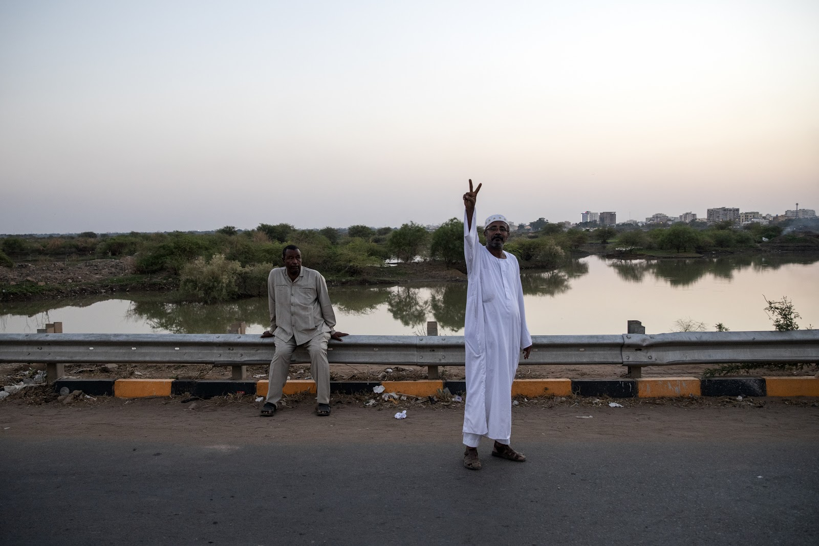 Demonstrator showing the victory in Khartoum