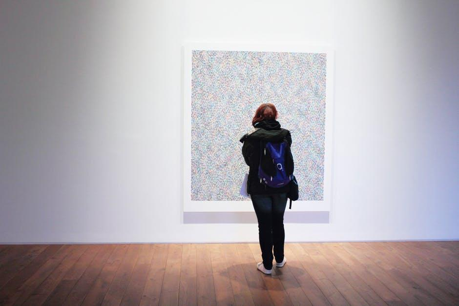 Woman Standing In front of a Wall Mount Painting- Cocoweb
