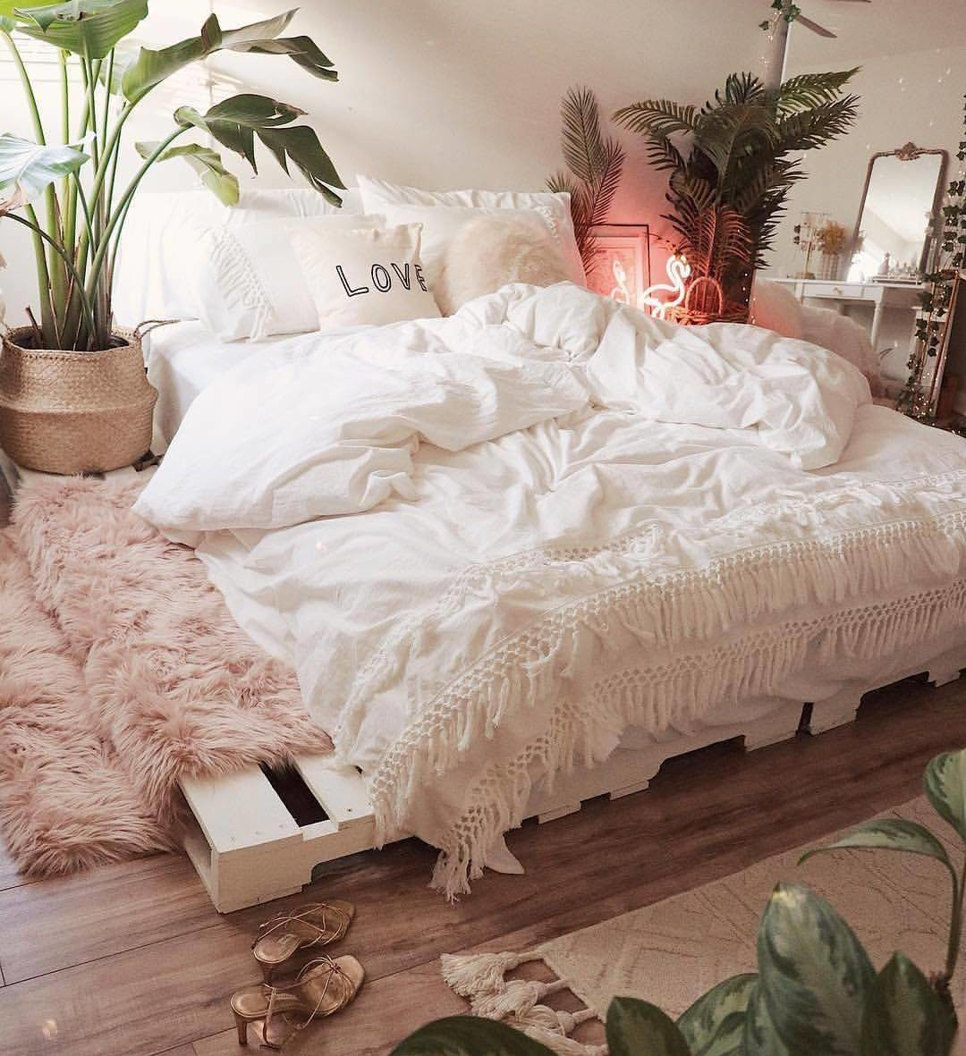 Airy Tropical Bedroom with A Pallet Bed
