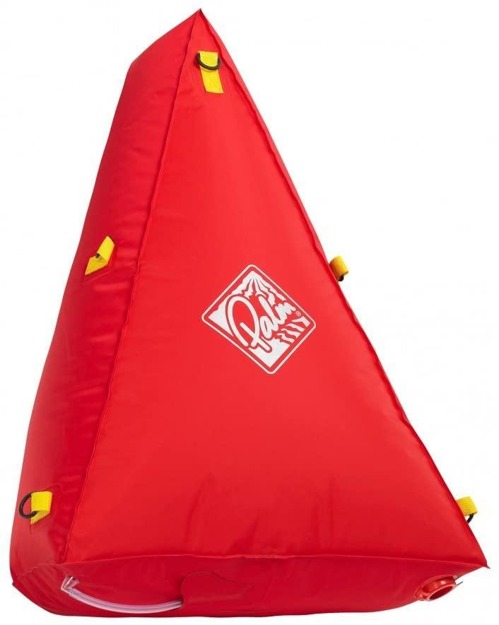 The image shows an inflatable pillow in a bright red color. The pillow has multiple tie off points to secure it to the fore or aft regions of a canoe. These pillows help avoid sinking a canoe.