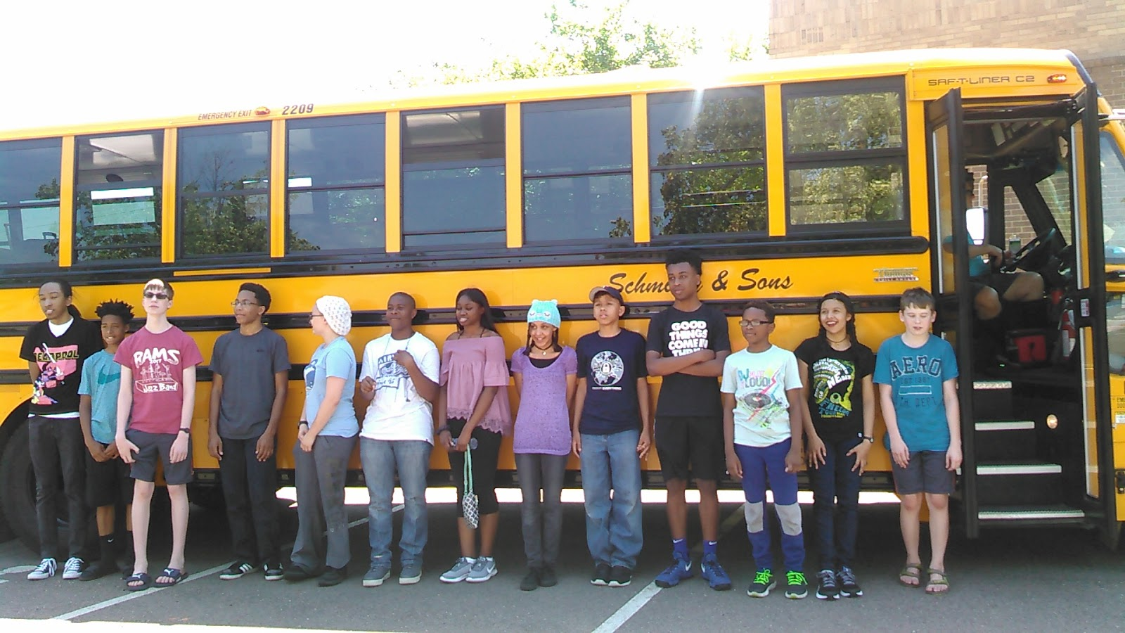 Twin Cities BDPA campers prepare to board the bus enroute to pick up additional campers from the Rochester area