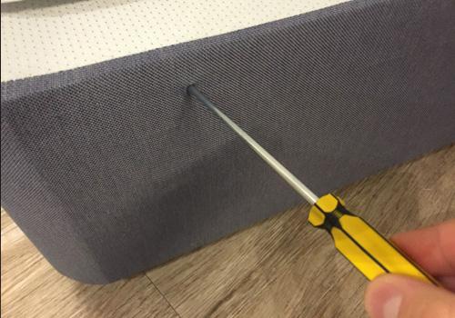 Pierce fabric in base for headboard bolt
