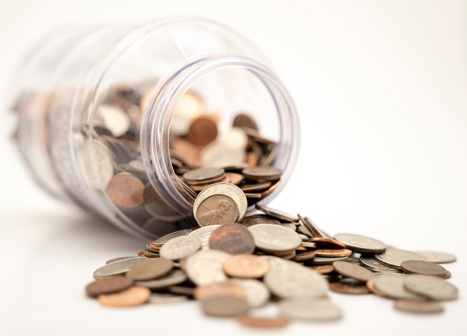 Coins spilling out of a jar.
