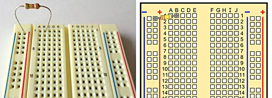 A breadboard with a 330K resistor.