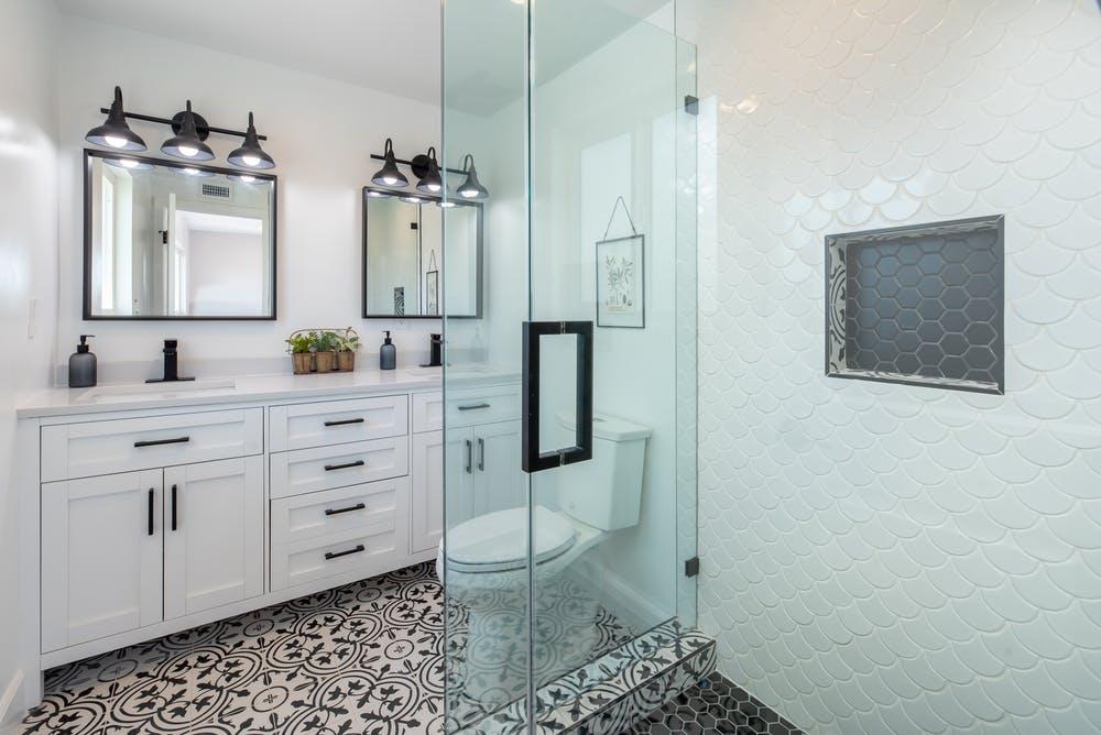 Bathroom cabinets with matte black hardware; MGSD interior design