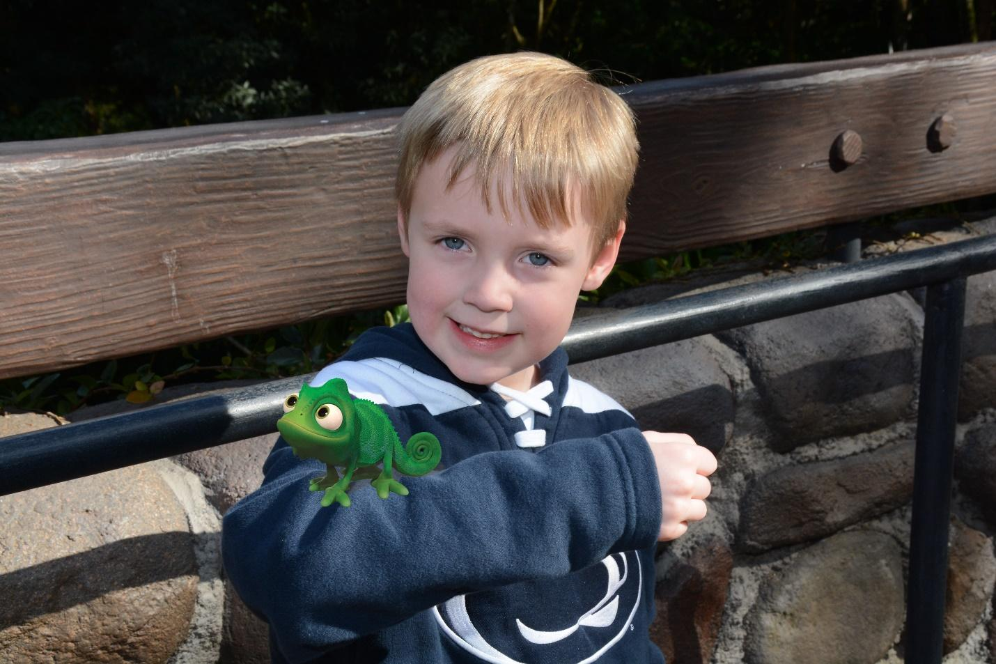 Disney's Memory Maker creates a fun interaction between Tangled lizard and small boy.