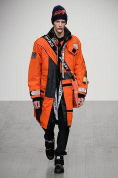 A picture containing person, orange, automaton  Description automatically generated