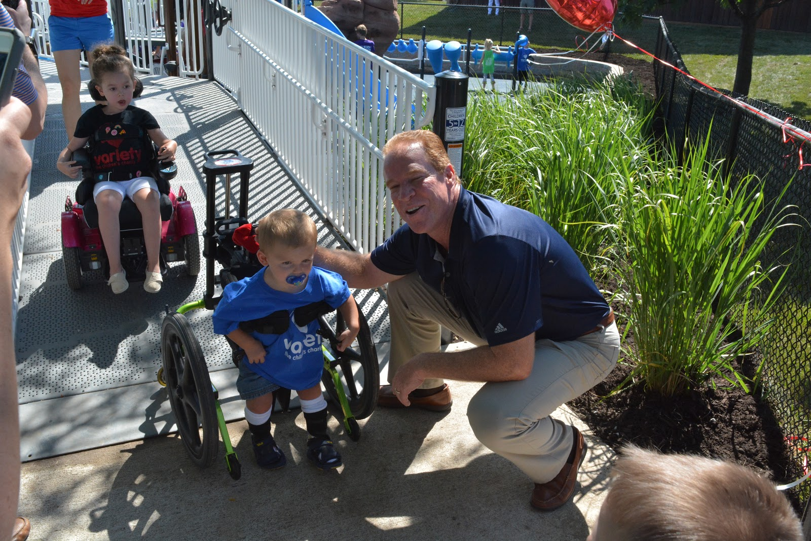 Rex Hudler poses with a small child at a Royals Charity event.