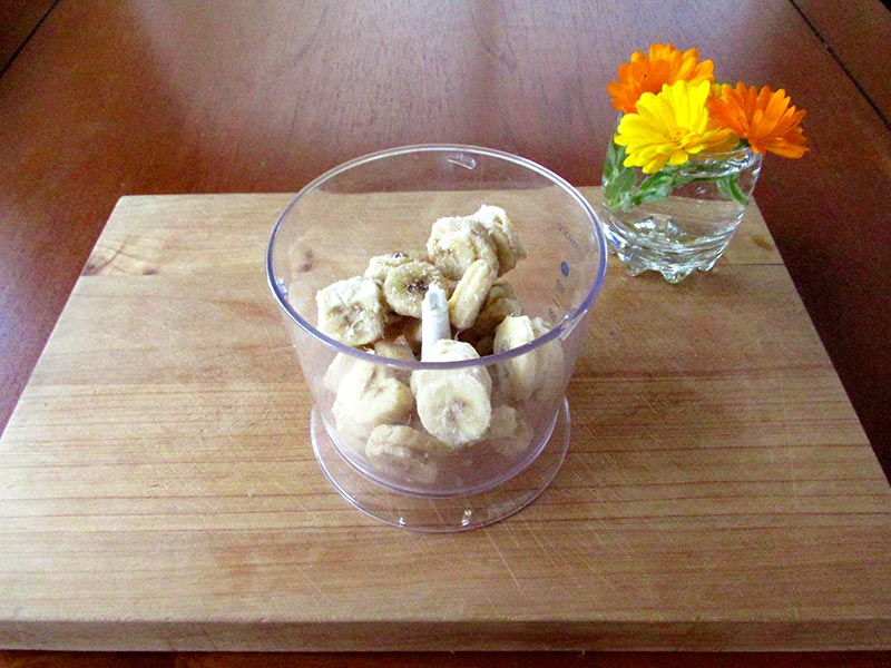 Blend the frozen bananas in a food processor to make this guilt-free ice cream recipe.