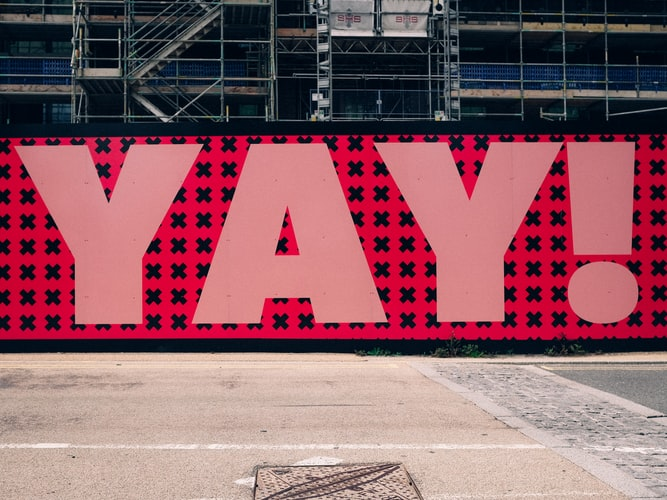 street art with the word 'yay!' painted in large letters.